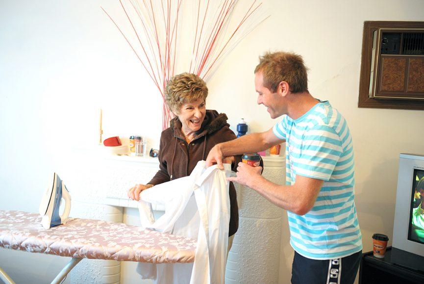 groom home getting ready coffee happy wedding Adelaide photographer South Australia photography iron shirt