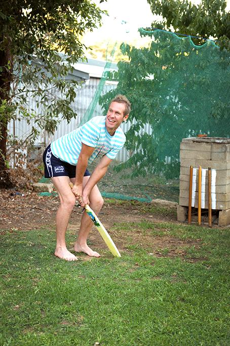 cricket sport outdoors happy Adelaide bat trees backyard South Australia groom t-shirt shorts wedding photographer photography