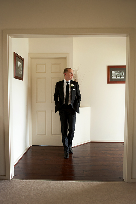 Groom home wooden frames suit tie flower white rose tie Adelaide wedding photographer South Australia photography