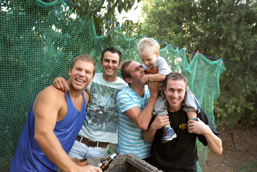 groomsmen Adelaide South Australia beer backyard netting outdoors happy groom wedding photographer trees photography Paige-boy