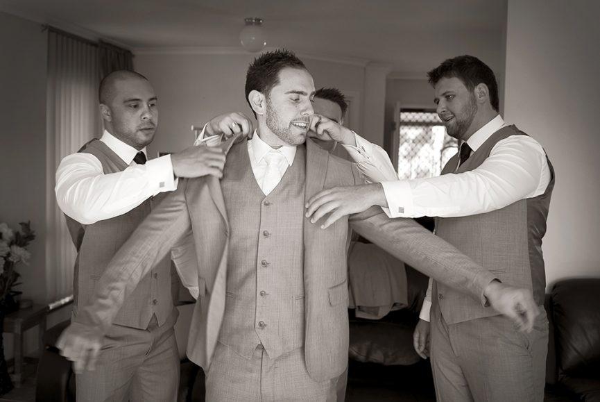 happy groom wedding suit tie blazer jacket groomsmen photography Adelaide home Italian photographer Australia getting ready