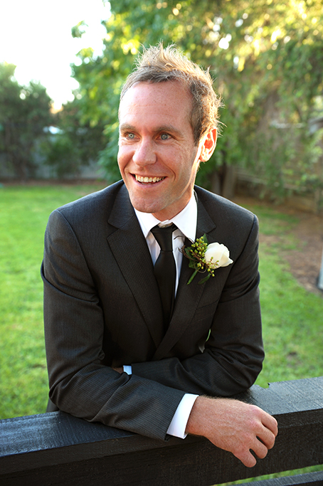 photographer Adelaide happy suit black grey tie green white rose flower happy groom photography wedding outdoors backyard trees South Australia