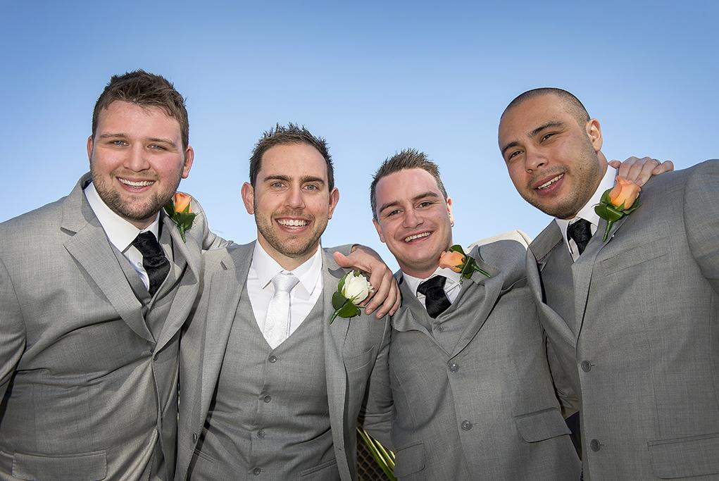 outdoors blue sky sunny Adelaide wedding photography groom groomsmen photographer peach orange flower grey suit black white tie Italian Australia
