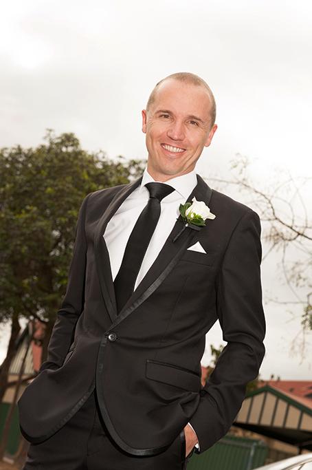 photographer happy groom black suit tie white shirt rose flower Adelaide wedding photography South Australia
