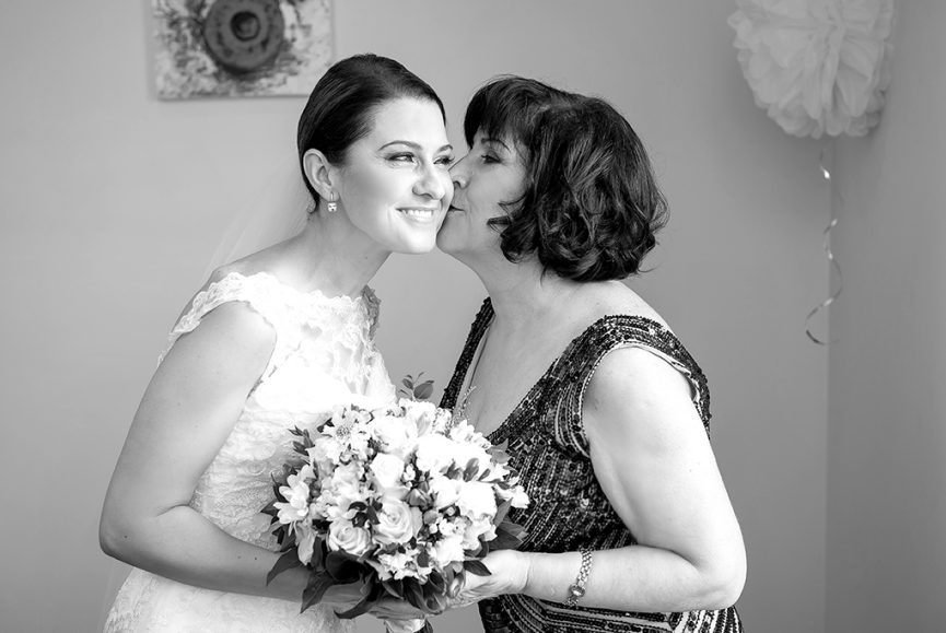 kiss love happiness bride wedding day lace dress Adelaide photographer flowers black and white photography bouquet
