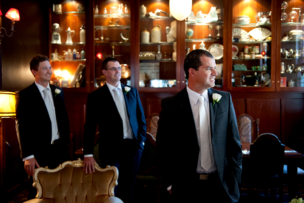 happy, love, joy, photographer, groomsmen, chair, cabinets, photography, fan, light, groom, Adelaide, suit, tie, white, Australia,  black, rose, wedding day, table, glass