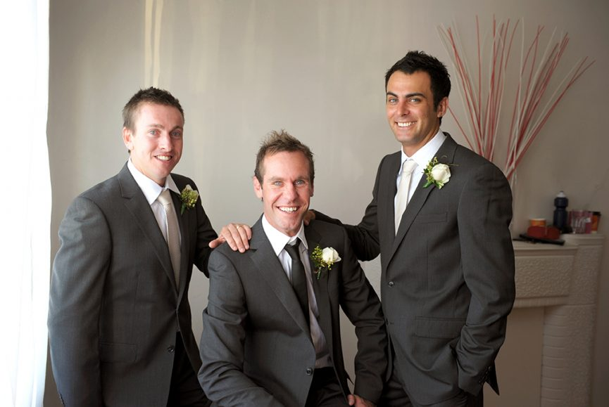 home indoors photography happy white rose South Australia black tie grey suit groom groomsmen home decor details wedding photographer Adelaide