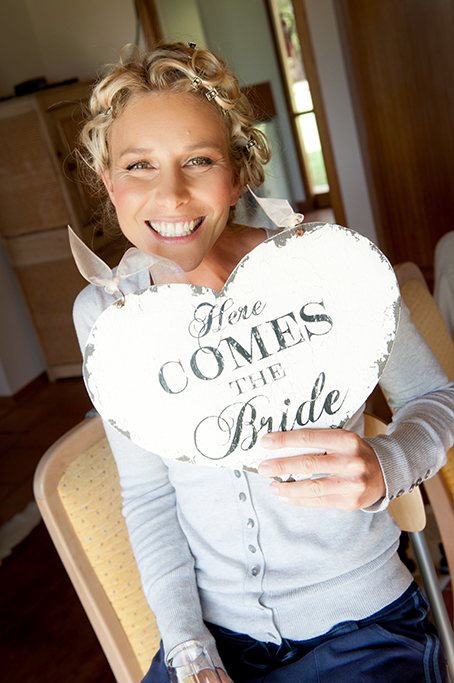 here comes the bride, heart, love, wood, chair, champagne, getting ready, hair, up-do, grey jumper, smiling, makeup, wedding day, country, rural, outback, South Australia, hair clips, photographer, buttons, photography