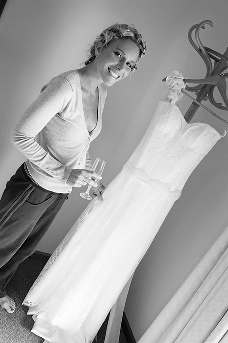 country, wedding, happy, bride, dress, rural, outback, grey jumper, track-pants, black and white, photography, smiling, makeup, hair, champagne, getting ready, hair clips, buttons, up-do, South Australia