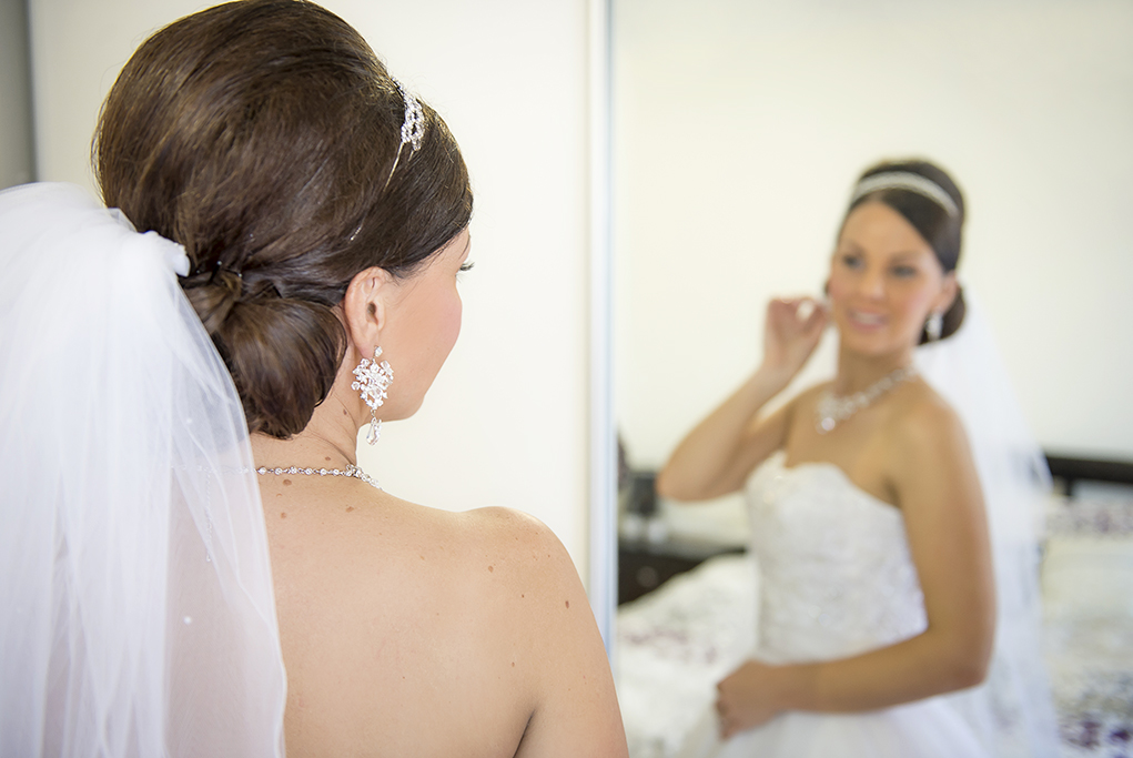 beautiful photography Adelaide Italian wedding bride photographer getting ready up-do hair silver headband white gold accessories necklace earrings dress sequins veil Australia bed bedroom