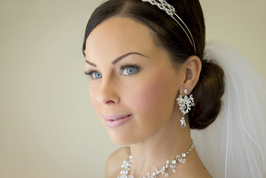 gorgeous makeup bride happy wedding day photographer Adelaide hair up-do white gold silver accessories necklace earrings veil Australia