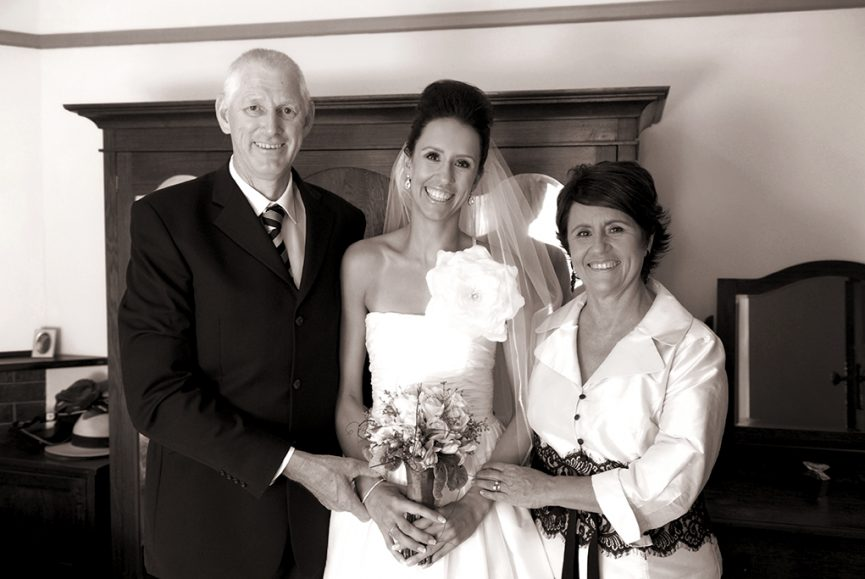 sepia photography happy family bride parents excited wedding flowers roses bouquet white black lace home photographer Adelaide South Australia