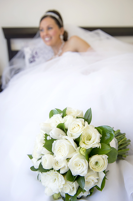 happy bride white roses bouquet Italian wedding Adelaide photographer bed bedroom photography hair up-do silver accessories white gold necklace earrings headband dress veil