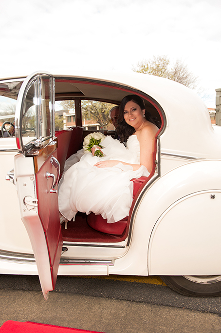 Adelaide wedding photographer bride Bethlehem Lutheran Church white dress roses bouquet happy car red leather interior photography red carpet