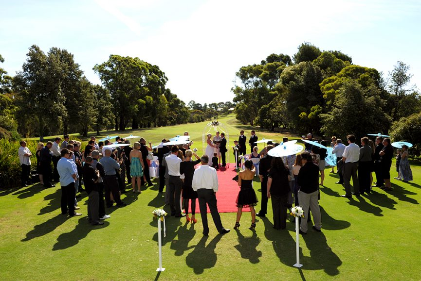 wedding, beautiful, sunny, day, blue, skies, green, grass, lawn, golf course, ceremony, family, friends, trees, umbrellas, Adelaide, red carpet, roses, white, photography, bouquet, flowers, bride, groom, photographer, Australia, bushes