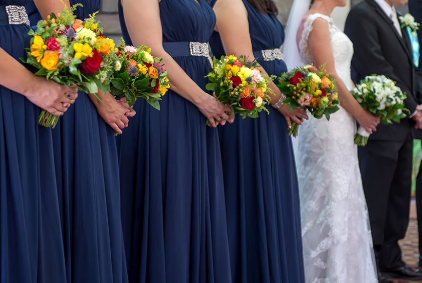 church flowers wedding ceremony colorful red yellow pink roses blue dresses bridesmaids bride lace photographer Adelaide bridal party  South Australia photography