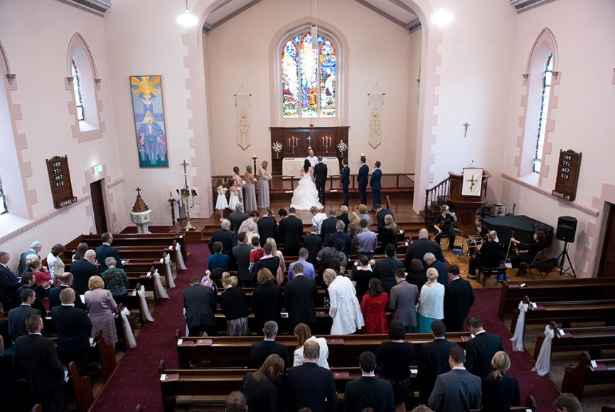 church ceremony guests wedding bridal party Bethlehem Lutheran Church bride groom photographer candles bridesmaids groomsmen orchestra grand piano Adelaide photography white flowers roses bouquet