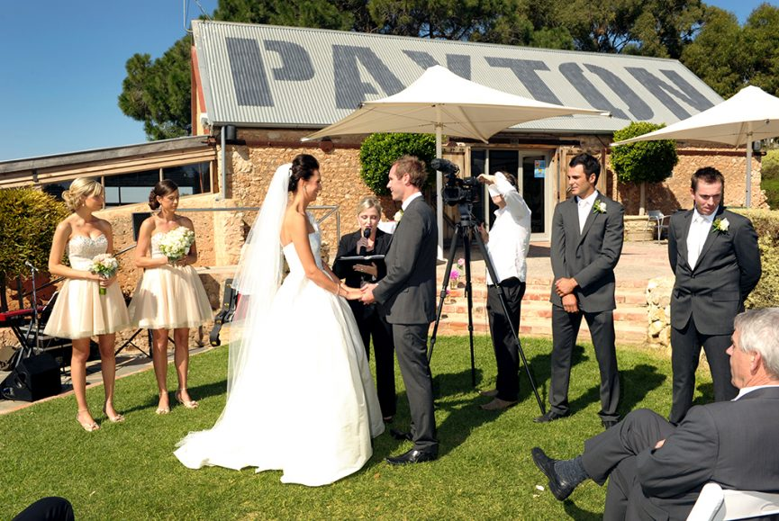 bridesmaids groomsmen celebrant wedding ceremony Paxton winery Adelaide sunny day South Australia happy white flowers roses bouquet guests photographer bride groom dress photography