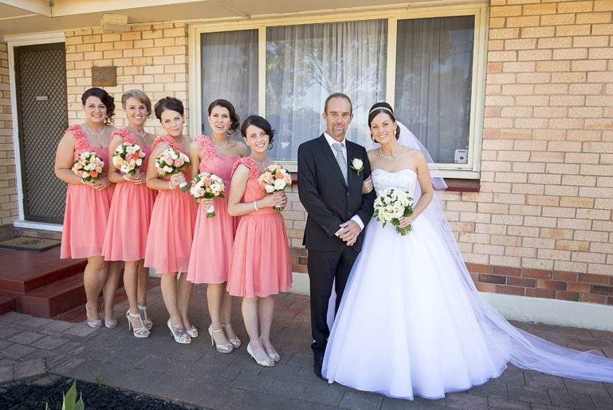 happy bridal party bridesmaids bride dad home Adelaide Australia peach one-shoulder style dress strapless wedding dress bouquet silver white gold accessories charcoal grey black suit tie photographer beautiful photography
