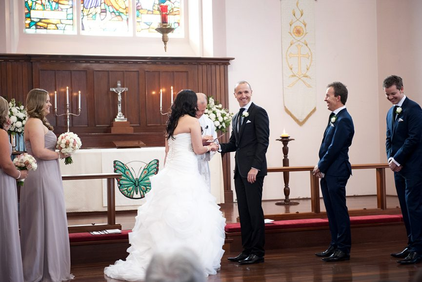Bethlehem Lutheran Church  wedding Adelaide photography candles blue green butterfly happy church ceremony bride groom white dress bridal party bridesmaids groomsmen black navy blue suits roses bouquet black shoes grey silver strapless pastel pink flowers beautiful photography South Australia photographer