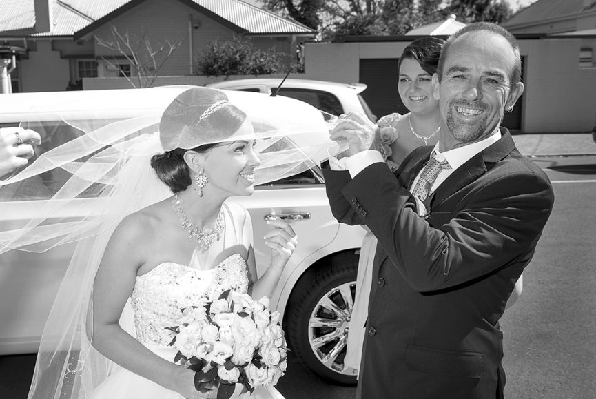 Italian bride happy dad father bridesmaid car black and white photography Adelaide photographer Australia veil strapless wedding dress sequins silver white gold accessories headband earrings necklace
