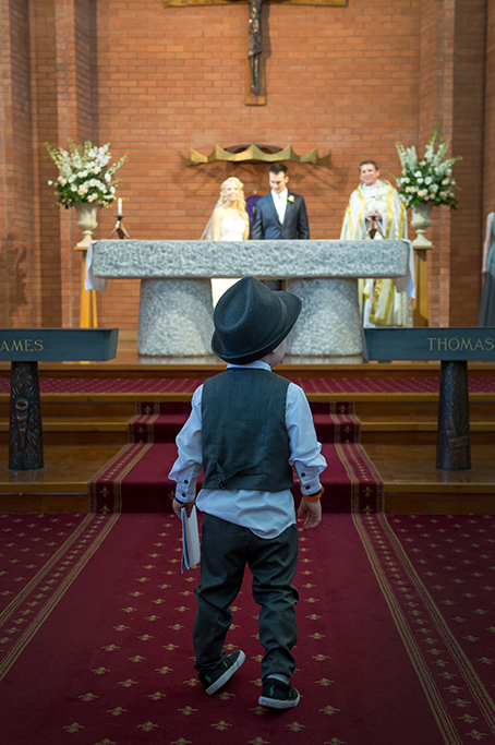 paige boy, wedding, church, priest, bride, groom, alter, Adelaide, Italian, South Australia, photographer, flowers, roses, bouquet, candles, hat, suit, dress, photography