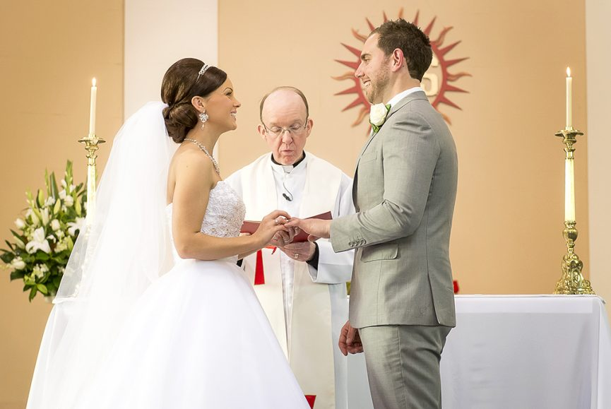 happy couple photography bride groom church Italian ceremony candles grey suit strapless wedding dress sequins rings vows priest white gold silver accessories headband necklace earrings Adelaide Australia photographer