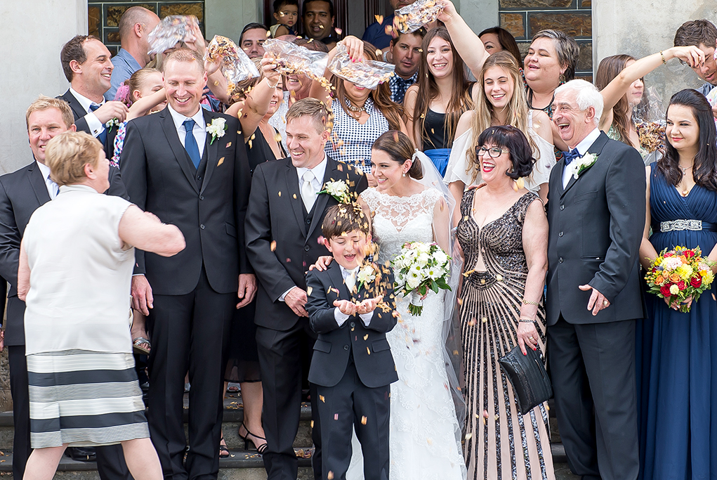 wedding ceremony church rose petals happy guests bride Paige-boy groom Adelaide photography cheers flowers bouquet lace dress suit photographer