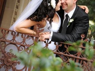 gardens, trees, greenery, fence, pretty, beautiful, architecture, happy, bride, groom, rose, veil, white, black, tie, jacket, suit, love, kiss, shirt, bangle, bracelet, Adelaide, wedding, hair, curls, dress, photography, city, Australia, photographer, architecture, pillars