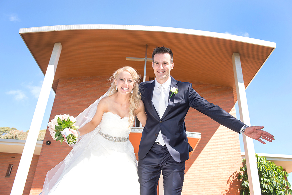 happy, joy, love, wedding, groom, Italian, bride, photography, church, Adelaide, South Australia, flowers, bouquet, roses, pastel, blue pinstripe suit, silver, white gold