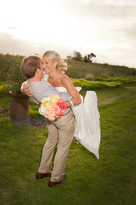 newlyweds, happy, love, wedding, photographer, evening, photography, South Australia, dress, blue shirt, grass, shrubs, flowers, roses, bouquet, colorful, apricot, white, pink, brown shoes, leather, yellow, trees, country, rural, lake, outback