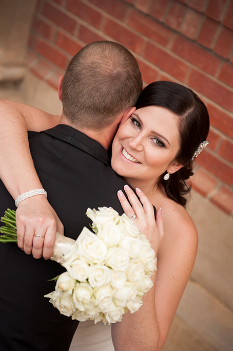 happy photographer bride Adelaide white roses bouquet silver sequins accessories groom love newlyweds wedding South Australia photography dress