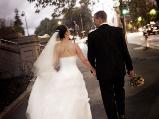 evening, city, north terrace, Adelaide, night, beautiful, candid, walking, holding hands, Australia, traffic, lights, trees, clouds, light post, dress, veil, suit, black, shirt, white, bouquet, road, photography, pink, roses, cars, flowers, shoes,  bride, wedding, newlyweds, groom, photographer