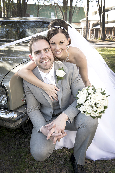 Adelaide parkland trees groom photography wedding bride happy newlyweds grey suit white tie roses bouquet dress veil silver white gold accessories photographer necklace headband earrings Holden car classic