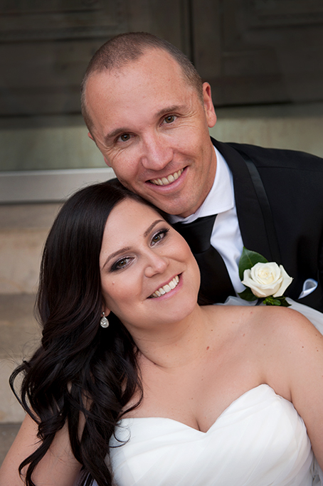 groom happy bride wedding photography Adelaide happy love newlyweds black suit white rose strapless dress silver accessories earrings beautiful photographer South Australia