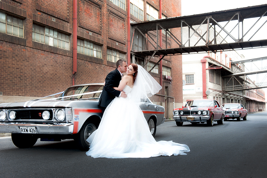 bride, port Adelaide, Australia, GT Mustang, cars, wedding, groom, old, factory, bricks, road, side-street, love, happy, veil, dress, white, suit, tie, shirt, black, kiss, photography, earrings, photographer