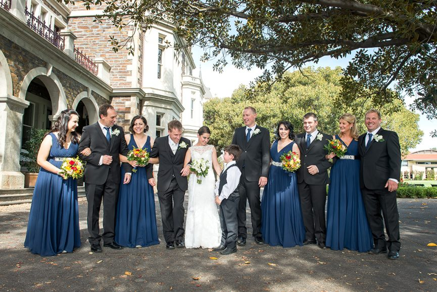 roses colorful flowers wedding happy bridal party photography groomsmen suits bridesmaids red pink yellow lace dress Adelaide photographer