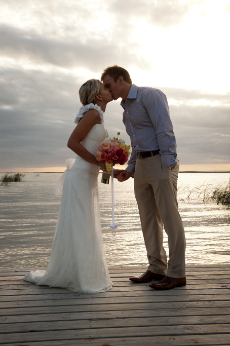 outback, country, rural, belt, brown, shoes, leather, wood, blue shirt, dress, yellow, apricot, pink, bouquet, colorful, flowers, roses, South Australia, photographer, sunset, pretty, photography, evening, groom, bride, love, happy, lakefront, romantic, lake