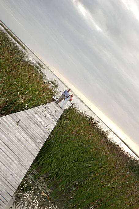 walking, happy, bride, groom, lake, wood, shrubs, photography, love, romantic, photographer, evening, sun, South Australia, sunset, flowers, colorful bouquet, blue shirt, pants, brown, dress