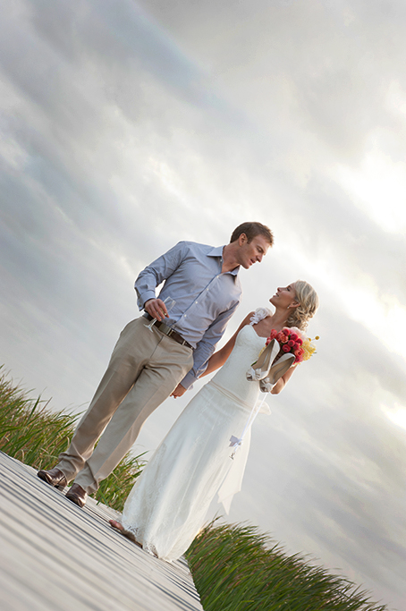 champagne, happy, love, South Australia, groom, bride, romantic, walking, photography, sky, clouds, evening, sunset, shrubs, lake, country, rural, beautiful, outback, blue shirt, dress, shoes, colorful, bouquet, roses, flowers, apricot, pink, yellow, white, brown, shoes, leather