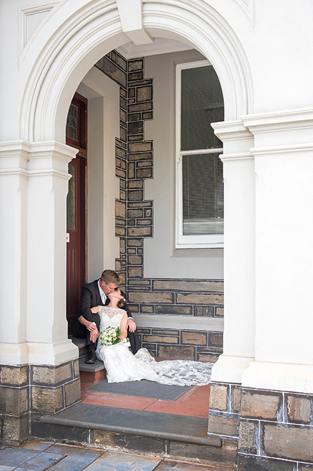 groom Adelaide bride kiss wedding photography Adelaide South Australia flowers kissing bouquet lace dress suit beautiful happy