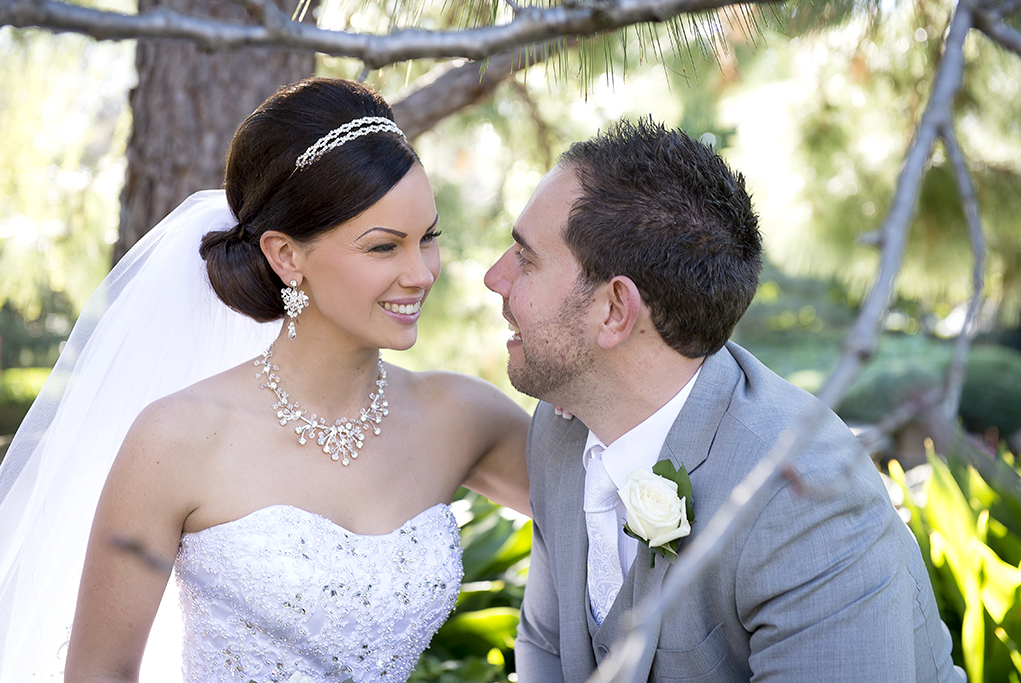 happy newlyweds Italian wedding photographer bride groom photography Adelaide strapless wedding dress sequins grey tie suit rose park trees hair up-do veil accessories silver white gold headband necklace earrings beautiful