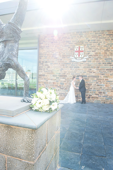 wedding day Adelaide photography flowers bouquet happy groom suit white roses bride lace dress sun glare beautiful South Australia photographer