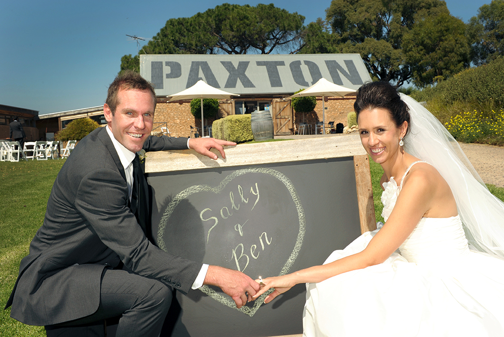 Paxton Winery Adelaide happy groom ceremony bride white wedding dress grey suit South Australia trees photographer happy newlyweds silver accessories sequins white gold
