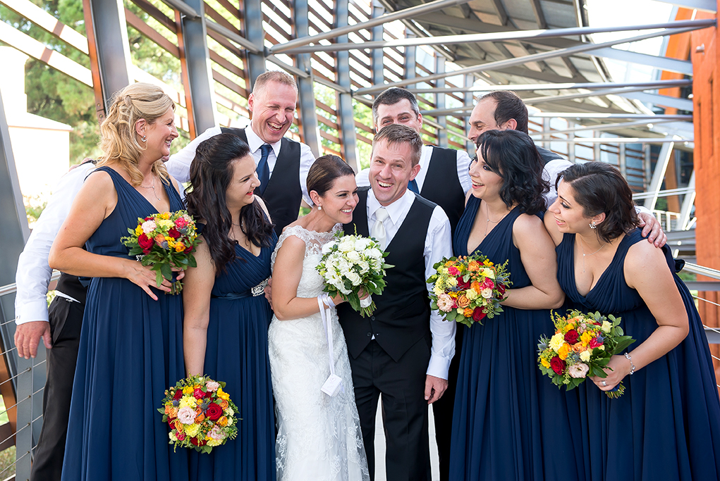 bridal party blue dress lace wedding flowers bouquet colorful red roses white pink orange yellow happy bride groomsmen suit tie bridesmaids laughter Adelaide photography South Australia wine centre photographer