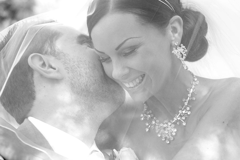 happy love newlyweds Italian wedding photographer bride groom photography Adelaide Australia kiss veil silver white gold accessories headband earrings necklace black and white Adelaide