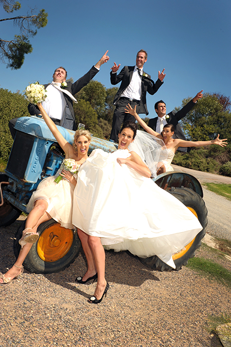 happy fun bridal party groom old tractor bride black shoes heels white wedding dress bouquet Paxton Winery Adelaide photographer trees photography