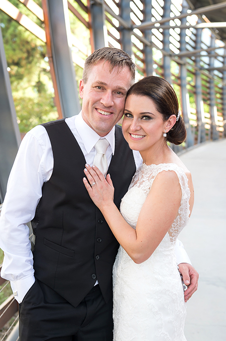 happy newlyweds bride lace dress groom suit Adelaide Wine Centre love wedding South Australia photography hair up-do photographer