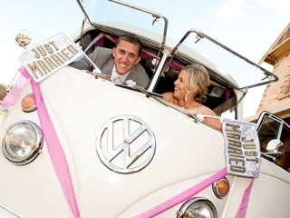 happy, joy, fun, wedding, photography, Volkswagen, van, classis, Australia, just married, bride, love, smile, groom, grey suit, white, rose, tie, dress, hair, up-do, sky, pink, ribbon, flags, sign, Adelaide, photographer