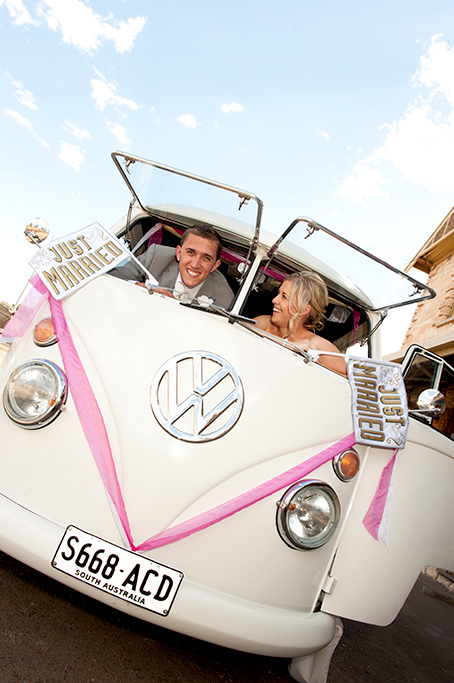 happy, joy, fun, wedding, photography, Volkswagen, van, classis, Australia, just married, bride, love, smile, groom, grey suit, white, rose, tie, dress, hair, up-do, sky, pink, ribbon, flags, sign, Adelaide, photographer